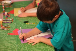 A child does arts and crafts at one of the churches this summer for Vacation Bible School.