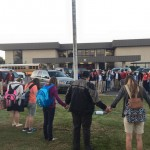 Students and faculty from Tioga High School join hands in prayer for their school, their nation, their friends, their family and more. Thousands of students all over the country joined together in unity, in prayer, for the annual See You at the Pole event. Photo by Joe Dupree.