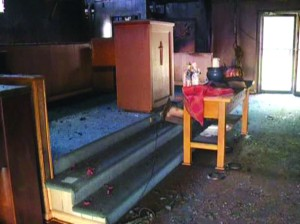 A photograph shows damage to the sanctuary of Bayou Baptist Church in Slidell from a fire on Oct. 22.