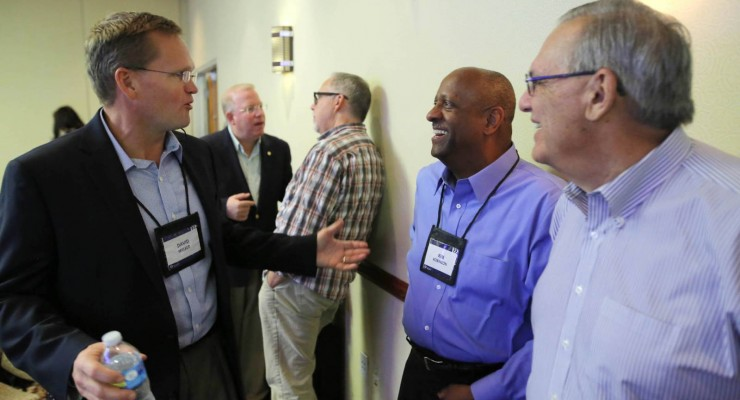 David Melber (left), who will lead the North American Mission Board's new Send Relief initiative, visits with NAMB vice president of marketing and ministry support Kim Robinson and NAMB executive vice president Carlos Ferrer (right) during the Oct. 7 meeting of NAMB's trustees.