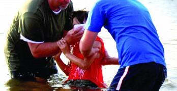 Church does lake, river baptisms HIS way