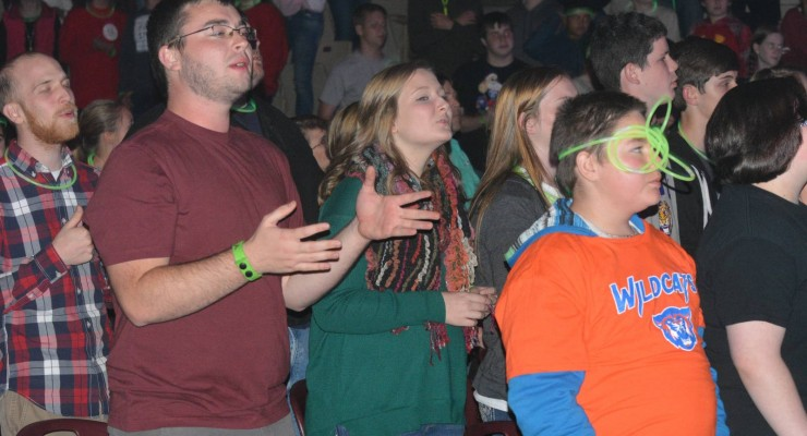 Youth and adult chaperons worship during YEC at the Cajundome in Lafayette. Brian Blackwell photo