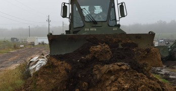 Louisiana National Guard  begins building protective barriers, patrols levees for approaching flood waters