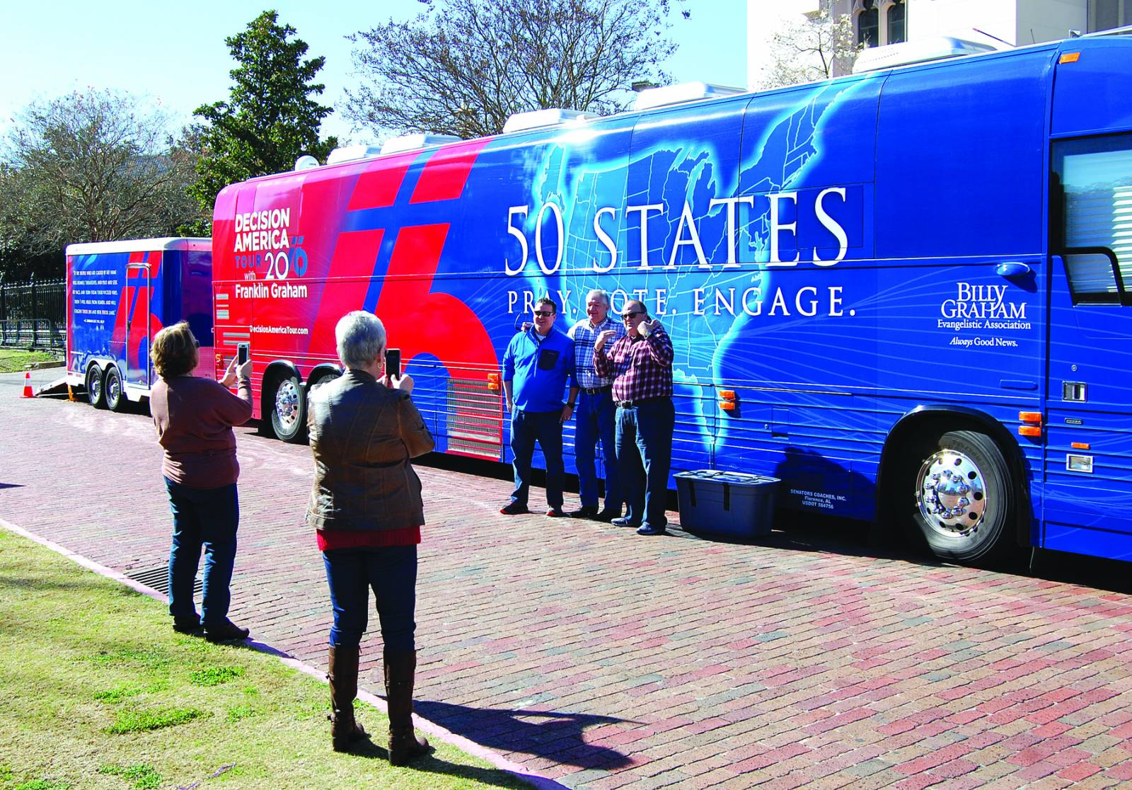 Ben Hackler, pastor of First Baptist Church Sterlington, his dad Dennis Hackler, and Sammy Morrow, pastor of Pleasant Hill Baptist Church in Pollock, pose for photos at one of two Franklin Graham Decision America Tour busses in downtown Baton Rouge on Jan. 13.