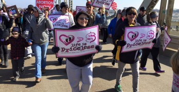 'Life is Priceless' marchers undaunted by winter's chill