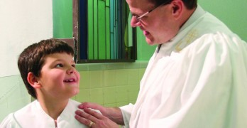 First Pineville Pastor treasures baptizing his son, sharing moment