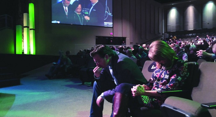 Brad Jurkovich, pastor of First Baptist Church, Bossier City, bows in prayer Jan. 31 at a Call to Prayer gathering taking place at First Bossier.   The prayer gathering of Northwest Louisiana Baptist Association of churches drew more than 1,400 people.