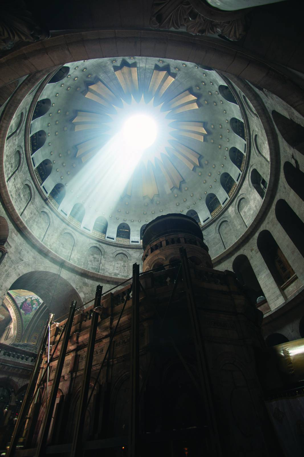Light spills through the rotunda of the Church of the Holy Sepulchre in Jerusalem onto the edicule, which many believe covers the empty tomb of Jesus. Photo by Gary D. Myers