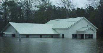 Rain weary Louisianans welcome sunshine, brace for flooding