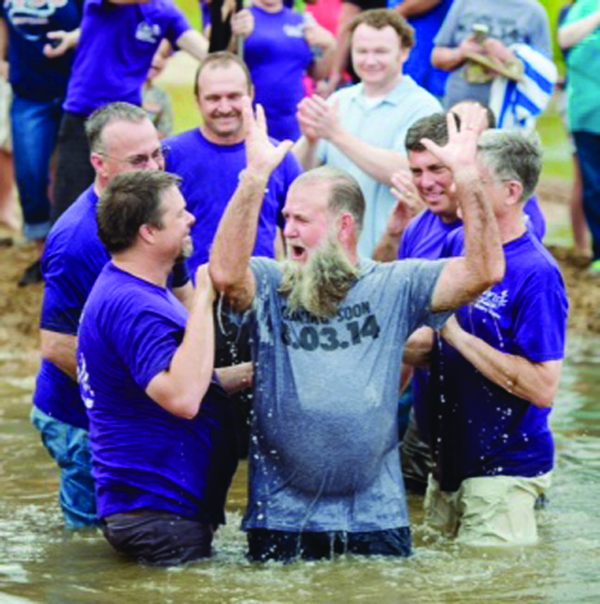 Christ's Community Church Pastor Willis Easley baptizes his older brother, Ken Easley,  in 2014. Forty people participated in the river baptism. Thirty-five people have signed up for the next river baptismal service on May 22.