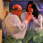 Minister of education and outreach Andrew Orr baptizes Cynthia Woodruff.  Pastor Philip Robertson is hopeful his church will surpass last year's 70 baptisms.