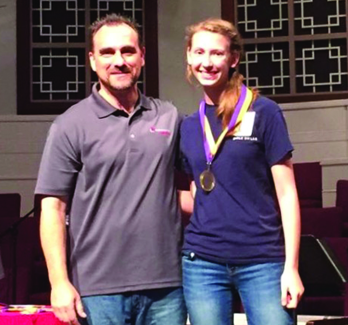 Chloe Whitehead, a ninth-grader, placed first at the State Bible Drill. She will represent Louisiana at the national competition. Steve Maltempi presented her with the winning award.