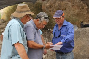 Dr. Dan Warner, Tsvika Tsuk and Eli Yannai talking about the excavation.