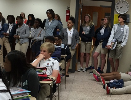 A large crowd fills a class room at Pineville Junior High School for a Fellowship of Christian Athlete meeting.