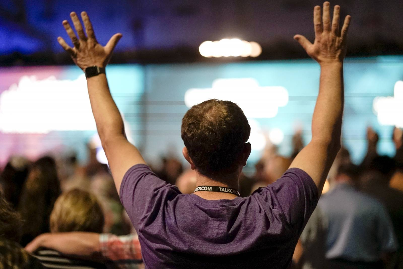 A messenger to the annual meeting of the Southern Baptist Convention raises his hands in worship during the National Call to Prayer for Spiritual Leadership, Revived Churches and Nationwide and Global Awakening Tuesday.