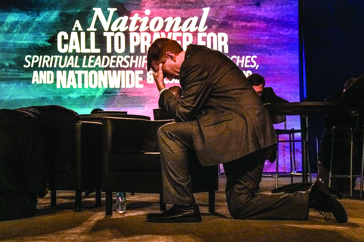 Sen. James Lankford (R-Okla.), prays for the country during the National Call to Prayer for Spiritual Leadership, Revived Churches and Nationwide and Global Awakening at the annual meeting of the SBC