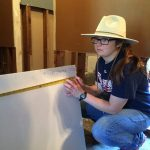 Laura Bertelson replaces drywall and paints inside a home in Hammond. Hank Taylor photo