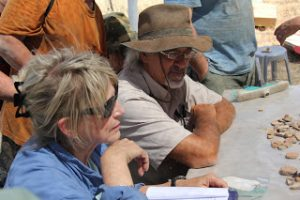 Dr. Warner and Lyn Pruitt working on pottery and artifacts.