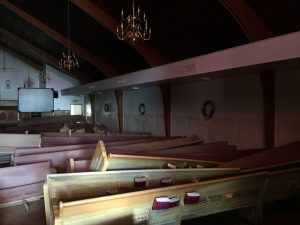 Damaged pews are scattered throughout the worship center of Don Avenue Baptist Church in Denham Springs.