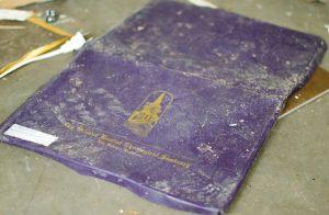 Thomas Fletcher's ruined diploma lies in the flood-damaged parsonage at Faith Baptist Church in Baker. Marilyn Stewart photo