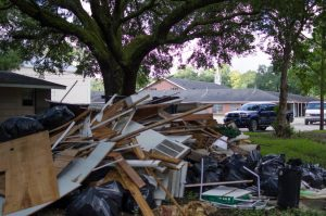 Piles of debris from the flood-damaged parsonage at Faith Baptist Church in Baker await removal. Marilyn Stewart photo