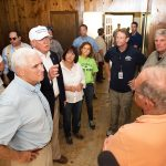 Indiana Governor Mike Pence, Republican presidential candidate Donald Trump, and Franklin Graham speak with homeowners. Karen Pence (white shirt) and Tony Perkins (dark blue shirt) are also pictured.