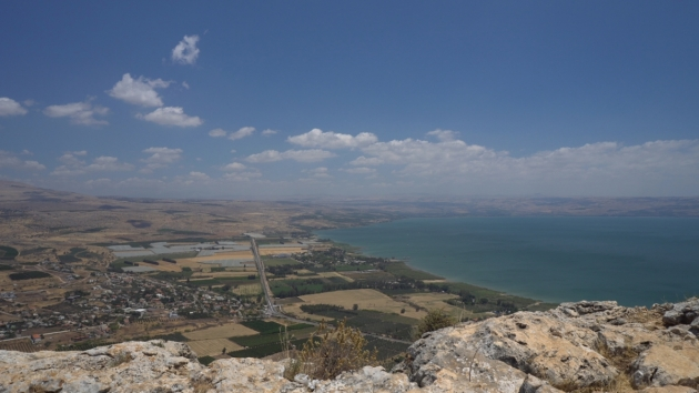 The Plain of Gennesaret on the northwest shore of the Sea of Galilee (standing on the heights of the Arbel looking northeast toward the north shore and Capernaum). Magdala, the hometown of Mary Magdalene, is on the shore just below the Arbel cliffs. Gamla is across and beyond the sea to the northeast. Photo by Eric Mitchell