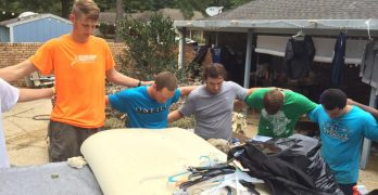 Students give up Labor Day holiday to help with flood recovery