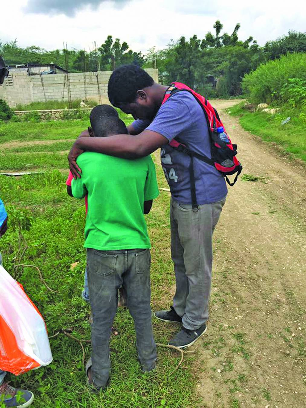 A Haitian boy is prayed for during a Louisiana Baptist mission trip to the country. Mission teams will be needed to build a children's village, medical clinic, pastor's training center and hotel in Haiti.