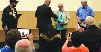 Jenkins, Lowrie receive medallions for evangelism work in Brazil
