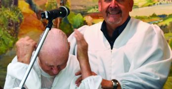 Despite wheelchair, 82-year-old baptized 'like Jesus'