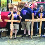 Stepping outside church walls: Handing out crosses leads to 14 professions of faith